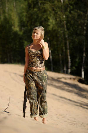 Woman with rifle Stock Photo - 15233502