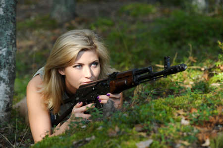 Woman with rifle Stock Photo - 15233279