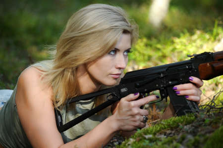 Woman with rifle Stock Photo - 15233288