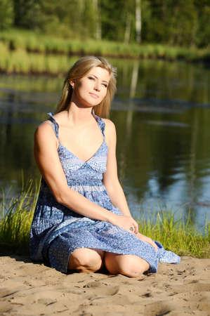 beautiful young woman in sundress near the lake Stock Photo - 15234099
