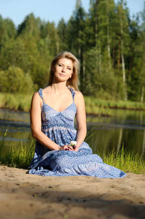 beautiful young woman in sundress near the lake Stock Photo - 15234102