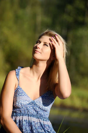 beautiful young woman in sundress near the lake Stock Photo - 15234097