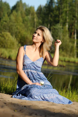 beautiful young woman in sundress near the lake Stock Photo - 15234103