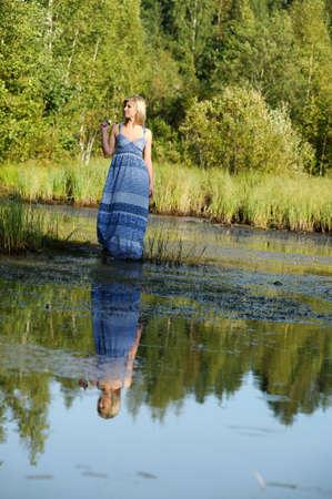 beautiful young woman in sundress near the lake Stock Photo - 15234129