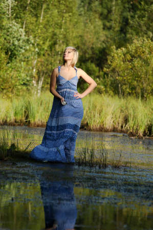 beautiful young woman in sundress near the lake Stock Photo - 15234104