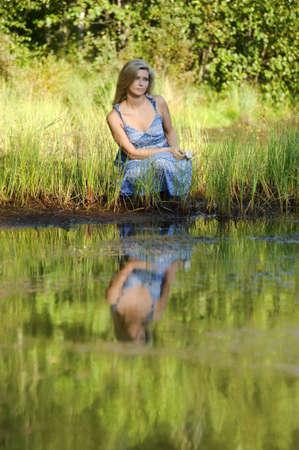 beautiful young woman in sundress near the lake Stock Photo - 15234101