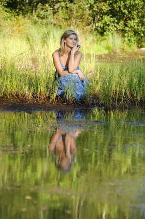 beautiful young woman in sundress near the lake Stock Photo - 15337856