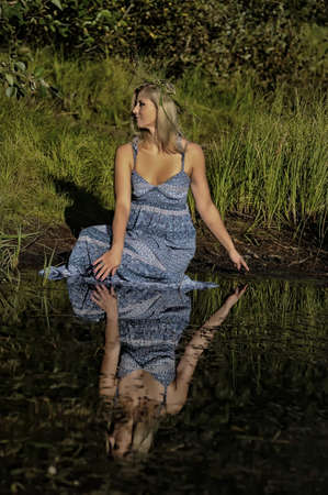 beautiful young woman in sundress near the lake Stock Photo - 15337857