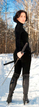 young woman with a katana in hand Stock Photo - 15657556