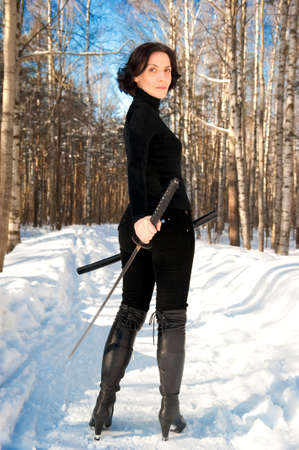young woman with a katana in hand Stock Photo - 15657559