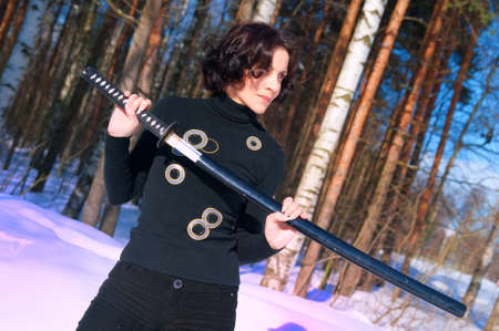 young woman with a katana in hand photo
