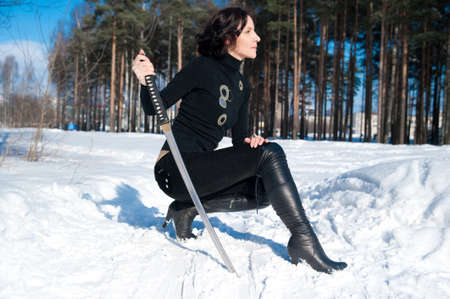 young woman with a katana in hand Stock Photo - 15657557