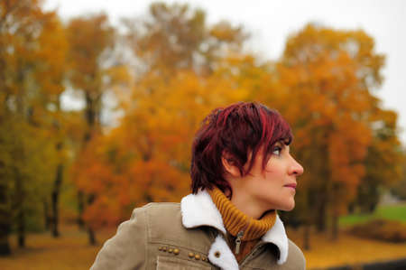 Young woman in autumn park Stock Photo - 15662011