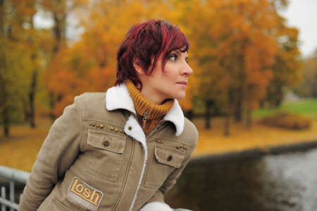 Young woman in autumn park Stock Photo - 15662012