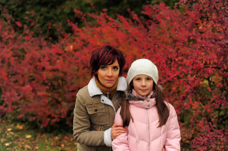 Mother with daughter in autumn park photo
