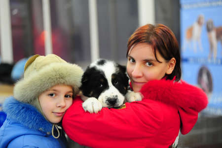 mother and daughter with a puppy Stock Photo - 15802977