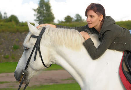 Woman on horse photo
