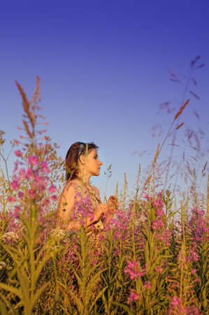 young woman in the field  photo