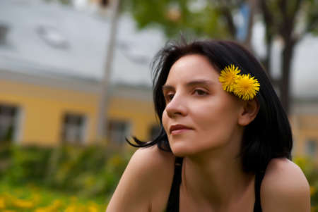 young woman with dandelions photo