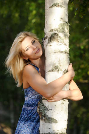 Girl near birch photo