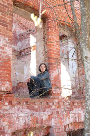 girl on the ruins of the destroyed brick house Stock Photo - 15554764