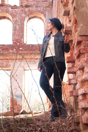 girl on the ruins of the destroyed brick house Stock Photo - 15529893