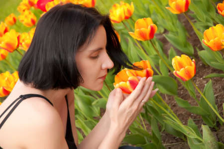 girl in the garden with tulips Stock Photo - 15358756