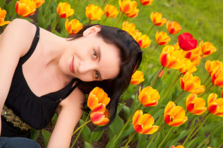 girl in the garden with tulips photo