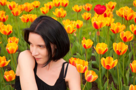 girl in the garden with tulips Stock Photo - 15358817
