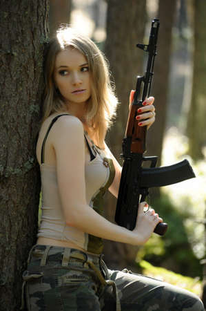 young blonde with a rifle photo