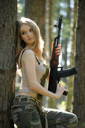 young blonde with a rifle in his hands Stock Photo - 15406525