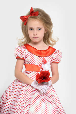 a little girl dressed in the style of the 60s Stock Photo - 15429159