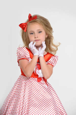 a little girl dressed in the style of the 60s Stock Photo - 15429157