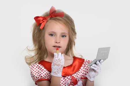 pinup girl: Pin-up girl applying her make-up Stock Photo