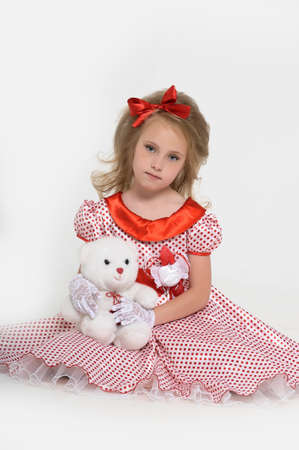 A little girl dressed in the style of the 60s Stock Photo - 15530496