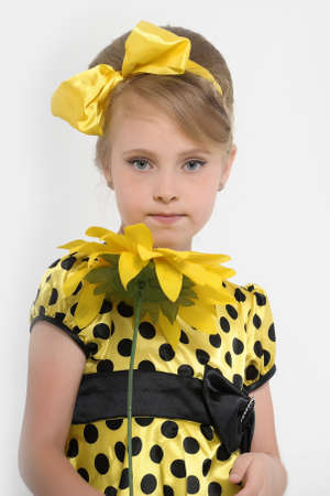 A little girl dressed in the style of the 60s  Stock Photo - 16194146