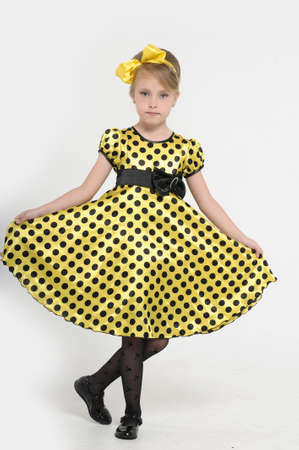 A little girl dressed in the style of the 60s  Stock Photo - 16194149