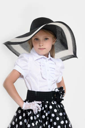 big girls: Girl in a big hat in the style of pin up  Stock Photo