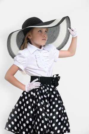 Girl in a big hat in the style of pin up  Stock Photo - 15887526