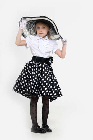 Girl in a big hat in the style of pin up  Stock Photo - 15887513
