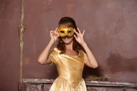 woman in gold dress photo