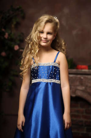 cinderella dress: little girl in an elegant blue dress