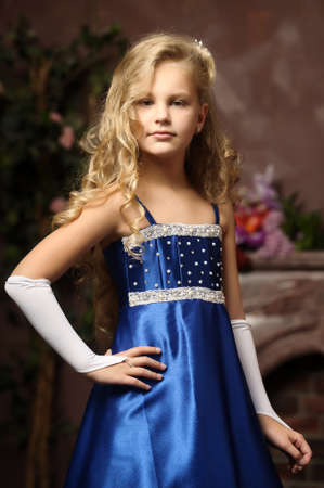 little girl in an elegant blue dress