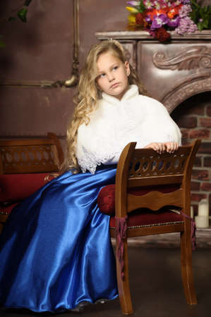 frock coat: beautiful blond girl in retro style Stock Photo