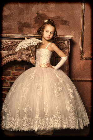 little girl dancing: little princess retro with umbrella