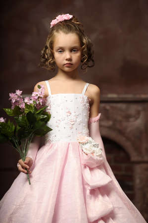 curtsy: little princess in a pink dress Stock Photo