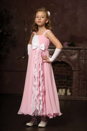 formal dress: little princess in a pink dress Stock Photo