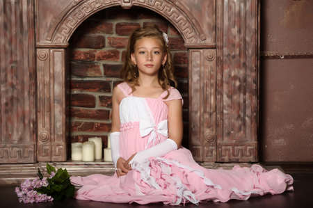 child girl nude: little princess in a pink dress Stock Photo
