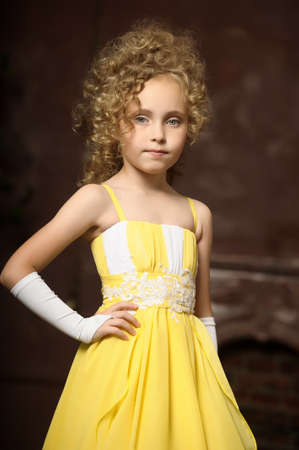 Girl in a yellow dress photo