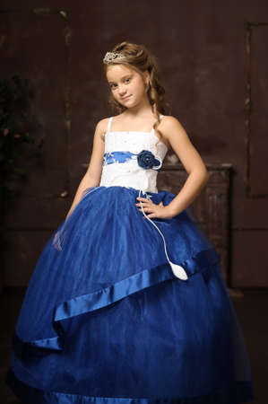 little princess in blue smart dress and tiara photo